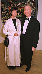 MR & MRS CLAUDE WADDINGTON, he is the art dealer, at a dinner in London on 8th March 1999.MPC 9