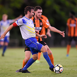 BRISBANE, AUSTRALIA - JANUARY 8: Michael Angus of Strikers passes the ball under pressure from Scott Fulton of Easts during the Kappa Silver Boot Group A match between Brisbane Strikers and Eastern Suburbs on January 8, 2017 in Brisbane, Australia. (Photo by Patrick Kearney)