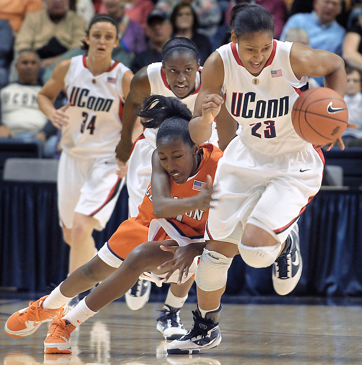 Connecticut's Maya Moore steals the ball from Clemson's Kirstyn Wright during the first half of an NCAA college basketball game in Storrs, Conn.