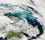 The clouds opened up enough on July 24, 2001, over the Barents Sea to reveal part of a suspected coccolithophore bloom to SeaWiFS. The personnel attempting to raise the sunken Russian submarine, the Kursk, probably have a good view of the milky water.