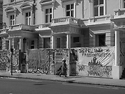 The day before the carnival. Residents and businesses board in front the their buildings. Notting Hill, London, 25 August 2017