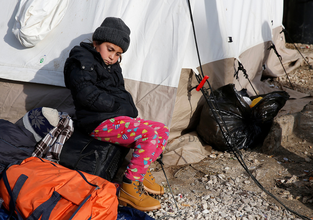 A migrant child rests outside a tent as refugees and migrants wait to continue their journey towards western Europe from the Macedonia-Serbia border at a transit camp in the village of Presevo, Serbia, February 2, 2016.<br /> Photo: Darrin Zammit Lupi