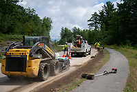 Mirra Utility Contractors for Comcast Cable Communications finish installing underground conduit at Turner Way in Laconia Wednesday.  (Karen Bobotas/for the Laconia Daily Sun)