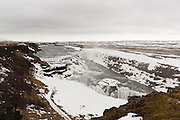 Gullfoss in late winter,after the first thaw has begun, still partially covered in snow and ice.