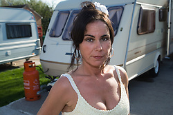 Woman standing outside her caravan,