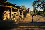 2014/11/22 – Quimili, Argentina: One of the houses in the allotment number 5 of the Guaycurú Indigenous Community. Many of the Guaycurú population still live in a traditional way with houses made of cob, a mixture of compressed clay and straw and surrounded by animals. (Eduardo Leal)