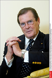© Greg Soussan/ABACA. 42159-3. UNICEF Goodwill Ambassador Roger Moore pose for our photographer at the George V Four Seasons hotel. He is in Paris to tape the tv show Absolument 70 (Absolutely 70's) for the M6 tv channel.
