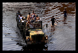 31st August, 2005. Aftermath of Hurricane Katrina, New Orleans, Louisiana. Refugees piled into a truck plough through the flood waters.