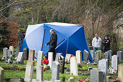© London News Pictures. 18/12/2013 . Didcot, UK. Police officers watch over a  forensics tent in a graveyard at All Saints Church in Dicot where police have started searching in connection with the disappearance of teenager Jayden Parkinson who has been missing since December 3rd. 22 year-old Ben Blakeley has been charged with the murder of 17-year-old Jayden. Photo credit : Ben Cawthra/LNP