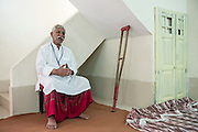 Nazir Lakha prays at the newly renovated '7th Day Church' in Joseph Colony.