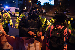 London, UK. 5th May, 2021. Metropolitan Police officers clear activists from Marylebone Road during a March On The Motorway event organised by Burning Pink to coincide with the eve of the London Mayoral elections. Burning Pink is a radical political party campaigning for rapid action to combat the climate emergency through the setting up of citizens assemblies and its candidate Valerie Brown is standing for London Mayor.