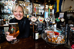 Edinburgh, Scotland, UK. 4 June 2020.  As Covid-19 lockdown relaxation continues in Scotland very few shops and businesses are open. Streets remain quiet and pubs and, with a few exceptions, bars and pubs are closed. Pictured; Anna Christopherson, owner of Joseph Pearce bar on Elm Row is offering takeaway drinks. Iain Masterton/Alamy Live News