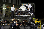 Kiryas Joel, New York - Members of an ultra-Orthodox Jewish community prepare  a bonfire celebration marking the Jewish holiday of Lag Baomer, Saturday, May 17, 2014. Local organizers expected more than 50,000 Hasidic people to attend what they say is the largest such celebration in the United States.