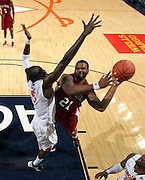 CHARLOTTESVILLE, VA- NOVEMBER 13: Dante Wooten #21 of the South Carolina State Bulldogs shoots inext to Assane Sene #5 of the Virginia Cavaliers during the game on November 13, 2011 at the John Paul Jones Arena in Charlottesville, Virginia. Virginia defeated South Carolina State 75-38. (Photo by Andrew Shurtleff/Getty Images) *** Local Caption *** Assane Sene;Dante Wooten