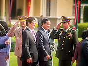23 JULY 2015 - BANGKOK, THAILAND:  NGUYEN TAN DUNG (left), Prime Minister of Vietnam,  and PRAYUTH CHAN O-CHA, Prime Minister of Thailand, walk past members of their respective delegations at Government House in Bangkok. The Vietnamese Prime Minister and his wife came to Bangkok for the 3rd Thailand - Vietnam Joint Cabinet Retreat. The Thai and Vietnamese Prime Minister discussed issues of mutual interest.     PHOTO BY JACK KURTZ