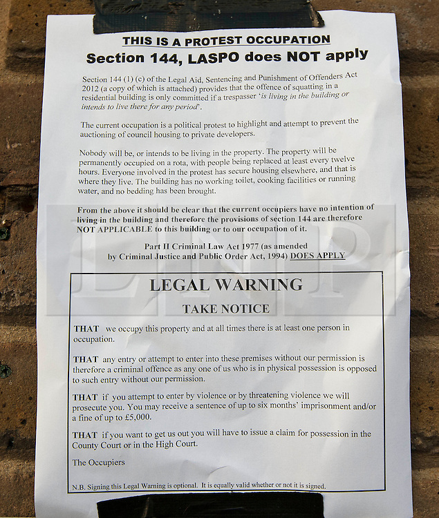 © Licensed to London News Pictures. 29/10/2013. London, UK. A notice put up by squatters occupying an 1820s property that was sold at auction on Monday for GB£3m is seen on the edge of London's Borough Market today (29/10/2013). The Grade II-listed building, sold by Southwark Council to build 20 new council homes, had been empty for years before squatters from Housing Action Southwark and Lambeth (HASL) moved in. The property, formerly owned by Courage brewers, was acquired by Labour-controlled Southwark Council when the Greater London Council was wound up in 1986. Photo credit: Matt Cetti-Roberts/LNP