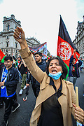 """Afghan women chant and gesture while as they march towards Parliament Square during a protest """"Save Afghanistan"""" outside Downing Street, Britain's PM Office in central London on Saturday, Aug 21, 2021. (VX Photo/ Vudi Xhymshiti)"""