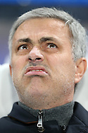 Jose Mourinho, the Chelsea Manager looking up at the sky pulling a face in the dugout before k/o. UEFA Champions league group G match, Chelsea v Porto at Stamford Bridge in London on Wednesday 9th December 2015.<br /> pic by John Patrick Fletcher, Andrew Orchard sports photography.