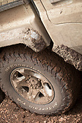 Close-up of the wheel of a dirty 4x4 safari car with mud, Ngorongoro Conservation area, Tanzania