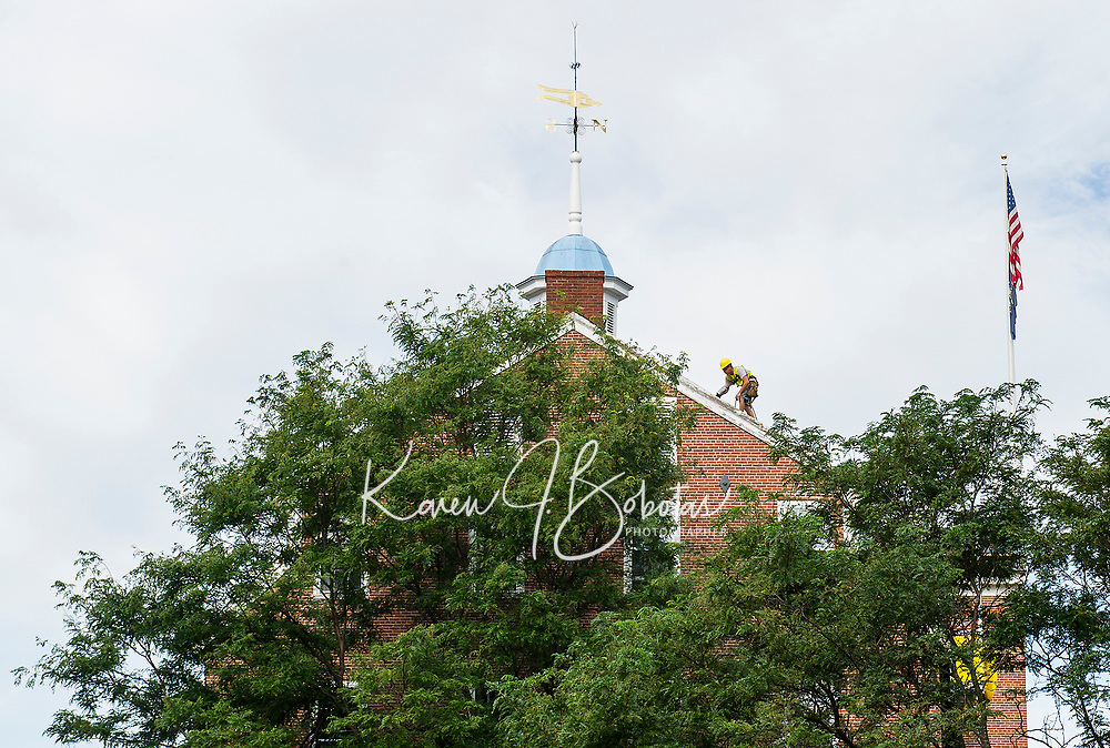 Roofing crew during the installation of the new roof to the Belknap Mill.  (Karen Bobotas Photographer)