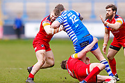 London Broncos loose forward Matthew Davis (13) tackles Halifax RLFC second row Simon Grix (12)  during the Betfred Championship match between Halifax RLFC and London Broncos at the MBi Shay Stadium, Halifax, United Kingdom on 8 April 2018. Picture by Simon Davies.