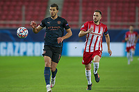 PIRAEUS, GREECE - NOVEMBER 25: Rúben Dias of Manchester City and Kostas Fortounis of Olympiacos FC during the UEFA Champions League Group C stage match between Olympiacos FC and Manchester City at Karaiskakis Stadium on November 25, 2020 in Piraeus, Greece. (Photo by MB Media)