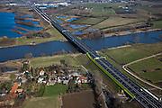 Nederland, Noord-Brabant, Den Bosch, 07-03-2010; Oud-Empel, rijksweg A2, brug over de Maas met de nieuwe fluorescerende gele geluidsschermen, ook de portalen zijn geel (Architect Ben van Berkel, routeontwerp voor de A2.Oud-Empel, A2, bridge over the river Meuse with new fluorescent yellow noise barriers, the portals are also yellow..luchtfoto (toeslag), aerial photo (additional fee required).foto/photo Siebe Swart