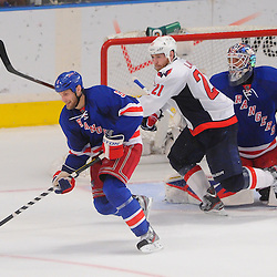 May 12, 2012: New York Rangers defenseman Dan Girardi (5) controls a rebound away from Washington Capitals center Brooks Laich (21) during the closing moments third period action in game 7 of the NHL Eastern Conference Semi-finals between the Washington Capitals and New York Rangers at Madison Square Garden in New York, N.Y. The Rangers defeated the Capitals 2-1.