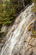 Water cascades down a rock face along the shore of Lake Willoughby in Vermont's Northeast Kingdom.
