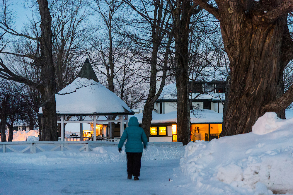 Participants in the Michigan DNR Becoming and Outdoors Woman stroll the wintry grounds at Bay Cliff Health Camp in Big Bay, Michigan.