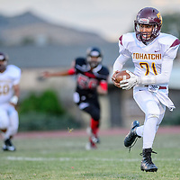 Tohatchi Cougar Brandon Lucero (21) rushes past the line of scrimmage at Grants High School Friday.