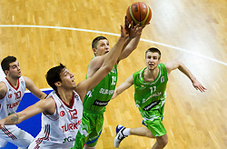 Onur Calban of Turkey vs Gezim Morina of Slovenia and Matej Rojc of Slovenia during basketball match between National teams of Turkey and Slovenia in Qualifying Round of U20 Men European Championship Slovenia 2012, on July 17, 2012 in Domzale, Slovenia. Slovenia defeated Turkey 72-71 in last second of the game. (Photo by Vid Ponikvar / Sportida.com)