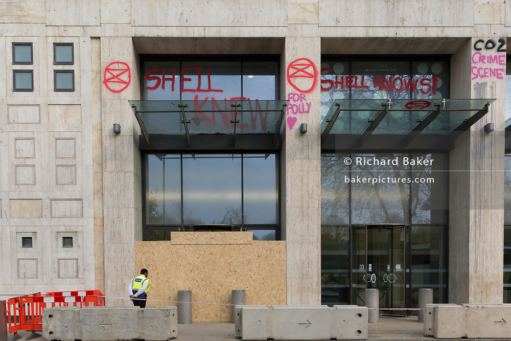 As protests continue across the capital by climate change activists with Extinction Rebellion, graffiti remains on the outside of Shell's London headquarters on the southbank, on 18th April 2019, in London, England.