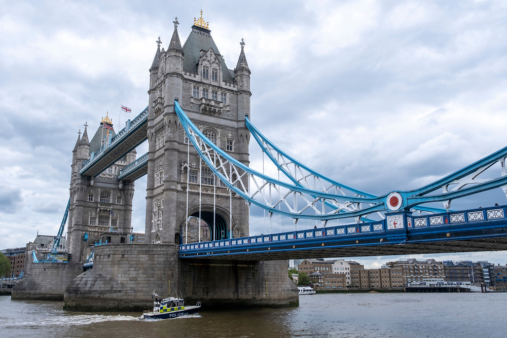 A British police boat on the river Thames passes under the iconic Tower Bridge on the 25th of May 2021 in London, England. (photo by Andrew Aitchison / In pictures via Getty Images)