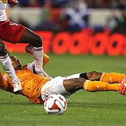 Bradley Wright-Phillips, (top), New York Red Bulls and Ricardo Clark, Houston Dynamo, collide as they challenge for the ball during the New York Red Bulls V Houston Dynamo, Major League Soccer regular season match at Red Bull Arena, Harrison, New Jersey. USA. 23rd April 2014. Photo Tim Clayton