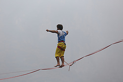 November 6, 2016 - Jiaozuo, Jiaozuo, China - Jiaozuo,CHINA-November 6 2016: (EDITORIAL USE ONLY. CHINA OUT)..Th¬®¬¶o Jim Daniel Sanson, a 29-year-old slackline walker from France, walks backward on a slackline in Yuntai Mountain in Jiaozuo, central China's Henan Province, November 6th, 2016, breaking the Guinness World Records by finishing the backward walking on slackline in six minutes and one second. The Guinness World Records Challenge Competition of Backward Walking on Slackline was held in Yuntai Mountain, Jiaozuo, Henan Province on November 6th, 2016. The French slackline walker Th¬®¬¶o Jim Daniel Sanson won the challenge competition and created a new Guinness World Record by walking the 100-meter-long slackline in about six minutes. Sanson said that he was very glad to win the competition and hoped that he could become a spokesman of Chinese environment because he was interested in scenic spots and environment in China. (Credit Image: © SIPA Asia via ZUMA Wire)