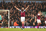 Aston Villa midfielder Mile Jedinak (15) celebrates Aston Villa striker (on loan from Bournemouth) Lewis Grabban (45) goal 1-0 during the EFL Sky Bet Championship match between Aston Villa and Leeds United at Villa Park, Birmingham, England on 13 April 2018. Picture by Dennis Goodwin.