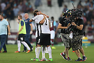 Filipe Teixeira of Astra Giurgiu hugs Geraldo Alves of Astra Giurgiu after the final whistle. UEFA Europa league, 1st play off round match, 2nd leg, West Ham Utd v Astra Giurgiu at the London Stadium, Queen Elizabeth Olympic Park in London on Thursday 25th August 2016.<br /> pic by John Patrick Fletcher, Andrew Orchard sports photography.