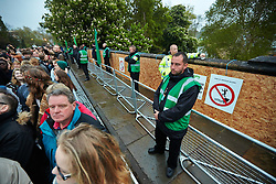 © Licensed to London News Pictures.  01/05/2014. OXFORD, UK. Security guards on Magdalen Bridge in Oxford on May Morning. Each year at 6am the Magdalen College Choir performs the Hymnus Eucharisticus, from the top of Magdalen Tower, a tradition dating back over 500 years. Around 6,000 students and local residents, some of who have stayed up all night, gather in the street below to listen. Morris dancers then perform around the city. After a number of injuries in previous years a heavy security presence stopped anyone from jumping from the bridge into the Cherwell river. Photo credit: Cliff Hide/LNP