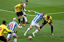 16 December 2017 - Premier League Football - Watford v Huddersfield Town - Christian Kabasele of Watford pulls on the arm of Laurent Depoitre of Huddersfield - Photo: Charlotte Wilson / Offside