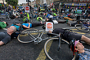 Cyclists protesting about another death nearby lie at Camberwell Green in the south London borough of Lambeth. On 28th May, NHS Physiotherapist Esther Silverhart was killed by a left-turning lorry, 100m from this location. Esther was the 6th cycling casualty this year, the 5th woman to die and all those incidents involving heavy lorries. Supporters of the action group Stop Killing Cyclists organsided the die-in, stopping traffic at this major road junction.