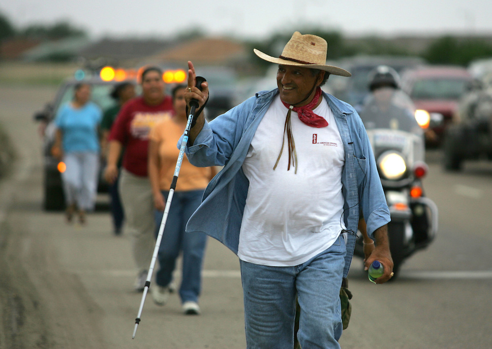 Jay Johnson Castro waves to a supporter in Brownsville on the morning of his 15th day of walking to protest the proposed border wall.