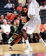 CHARLOTTESVILLE, VA- DECEMBER 6: Ryan Pearson #24 of the George Mason Patriots drives into Assane Sene #5 of the Virginia Cavaliers during the game on December 6, 2011 at the John Paul Jones Arena in Charlottesville, Virginia. Virginia defeated George Mason 68-48. (Photo by Andrew Shurtleff/Getty Images) *** Local Caption *** Assane Sene;Ryan Pearson