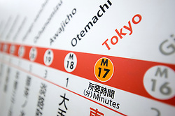 Detail of metro route and station information sign at Tokyo subway station in Japan