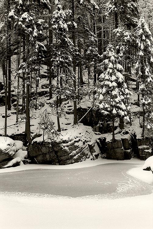 Frozen stream Szklarka in Karkonosze, Poland