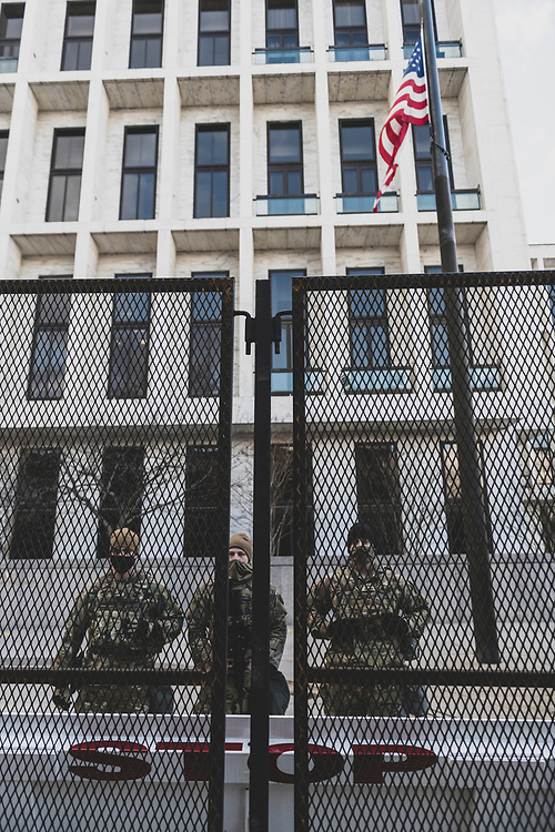 Washington DC, USA - January 18, 2021: Members of the National Guard stand outside the Hart Senate Office Building, facing 2nd Street NE.