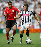 Photo: Rich Eaton.<br /> <br /> West Bromwich Albion v Barnsley. Coca Cola Championship. 01/09/2007. West Bromwich Albion's Filipe Teixeira (r) fends off the challenge of Anderson De Silva.