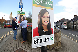 Sinn Fein election workers put up posters for candidate Orfhlaith Begley in Omagh canvasing for the upcoming West Tyrone by-election.