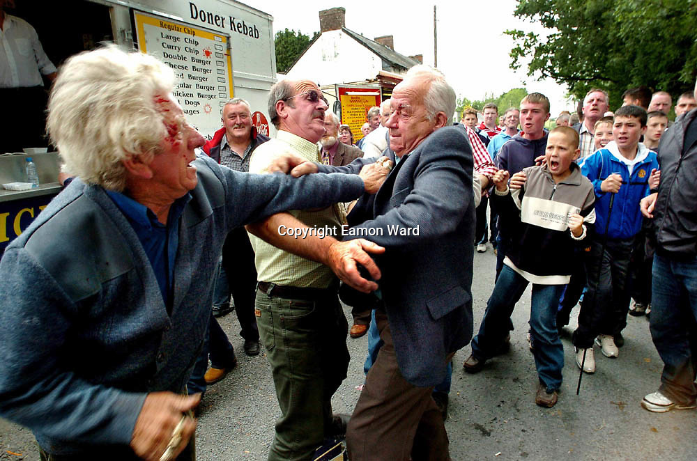 Two Elderly Gentlemen have a difference of opinion at Spancilhill Horse Fair,Co Clare, Ireland. Photograph by Eamon Ward