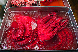 pickled and colored octopus tentacles for sale at wholesale shop, Tsukiji Fish Market or Tokyo Metropolitan Central Wholesale Market, the world's largest fish market, hadling over 2, 500 tons and over 400 different kind of fresh sea food per day